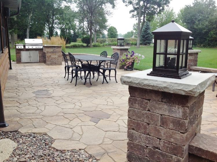 Lavish Entertainment: After patio with pillars and grill